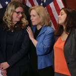 Sen. Kirsten Gillibrand, 2nd left, is joined by End Rape on Campus co-founders and sexual assault survivors Annie Clark, left, and Andrea Pino, 2nd from right, and Anna, a survivor of sexual assault at Hobart and William Smith Colleges at a July 30, 2014 news conference in Washington about legislation to curb sexual assaults on college and university campuses