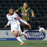 Rochester's Tony Walls, right, defends against D.C. United's Kyle Porter in a U.S. Open Cup game Tuesday.