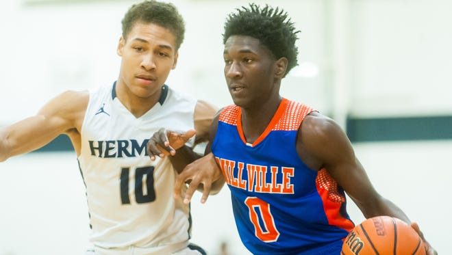Millville guard Rynell Lawrence (0) drives to the basket during a game last season.