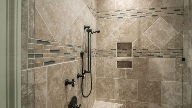 Shades of gray porcelain tiles present a sophisticated contrast in shapes and sizes.