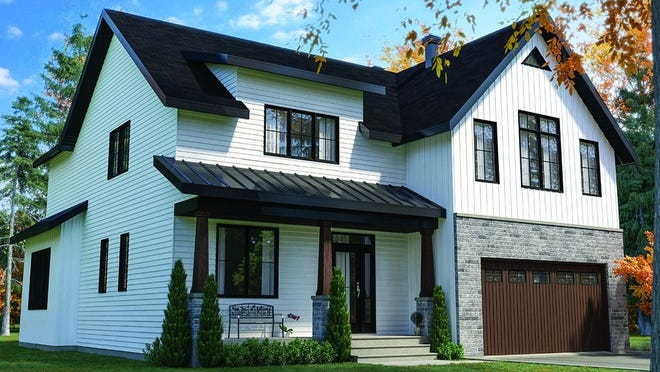 A metal roof and mixed siding deliver depth, while a front porch creates a welcoming vibe.
