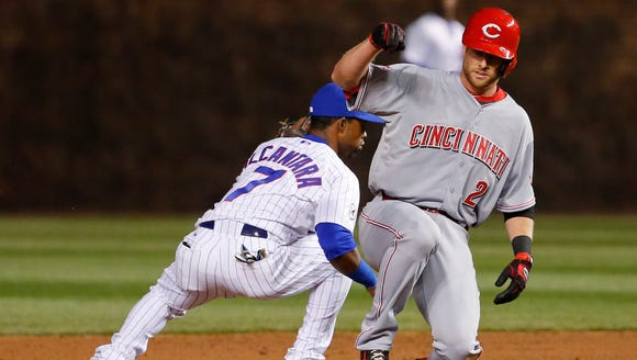 Reds shortstop Zack Cozart slides safely with a double