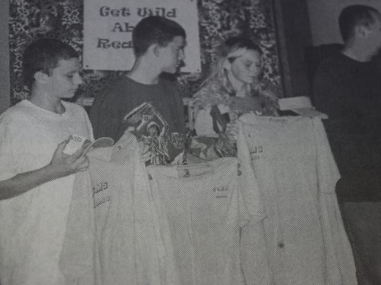 UCMS teacher Scott Uzzle, right, addressed the Union County School Board in October 2004 with three students, from left, Jackie Peckham, Butchie Piper, and Maria Hansbrough to show examples of embroidery work they had completed.