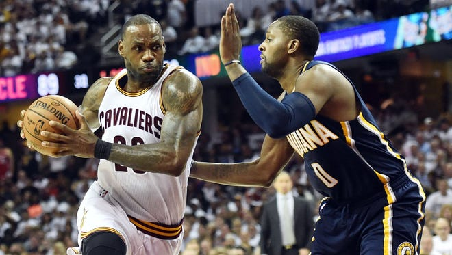Cleveland Cavaliers forward LeBron James (23) drives to the basket against Indiana Pacers forward CJ Miles (0) during the second half in game two of the first round of the 2017 NBA Playoffs at Quicken Loans Arena.