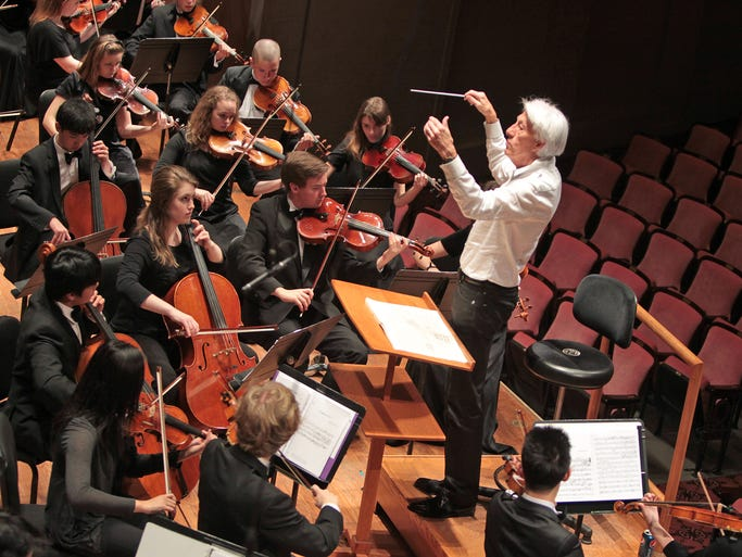 Music director Larry Livingston conducts the Honor Orchestra of America during practice at the Hilbert Circle Theatre during the Music for All National Festival, Friday, March 7, 2014.  The three-day-event, held in various Indianapolis venues, included performing, clinics, and master classes.  The honor bands and orchestra are made up of students from around the country.