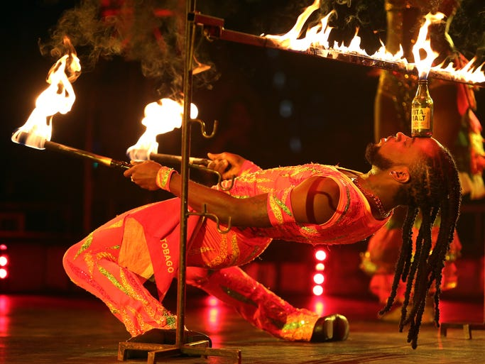 Caribbean Callaloo, of Trinidad, performs in the UniverSoul Circus at the Lafayette Square Mall in Indianapolis on Tuesday, July 15, 2014.