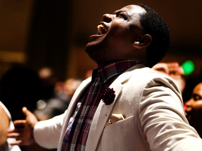 Jamal De'Von, of Fort Wayne, Ind., prays during the Gospel Explosion at the Black Expo Summer Celebration at the Indiana Convention Center in Indianapolis on Sunday, July 20, 2014.