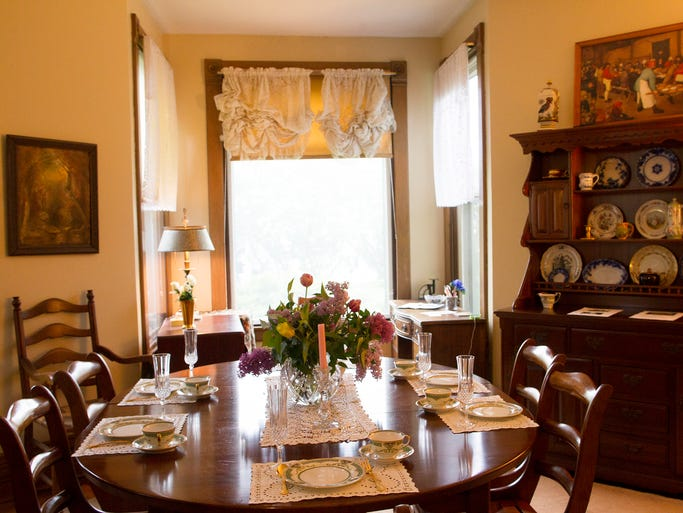 The dining room of College Green Inn on Johnson Street is seen on Sunday, May 11, 2014. The home was one of many that were open to the public as part of the seven-annual Parade of Historic Homes.   David Scrivner / Iowa City Press-Citizen