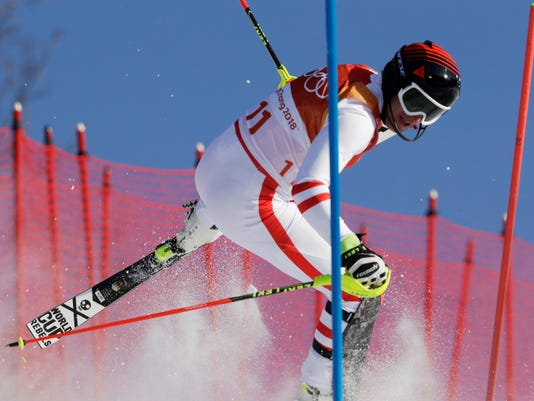 Austria's MatthiasMayer crashes during the slalom portion of the men's combined at the 2018 Winter Olympics in Jeongseon, South Korea, Tuesday, Feb. 13, 2018. (AP Photo/Luca Bruno)