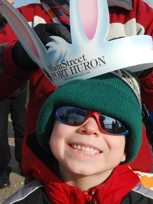 Thomas Schweihofer, 6, grins as his mom, Stacy, adjusts a pair of bunny ears.