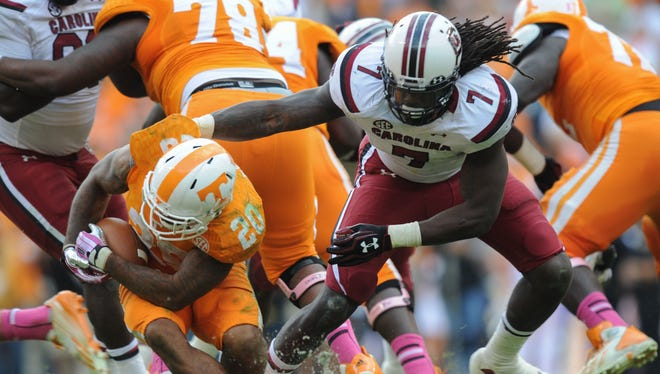 South Carolina DE Jadeveon Clowney (7) put quite a lick on Tennessee RB Rajion Neal (20) in the teams' Oct. 19 meeting.