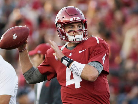 FILE - In this Sept. 2, 2017, file photo, Washington State quarterback Luke Falk warms up for an NCAA college football game against Montana State in Pullman, Wash. Falk won the Burlsworth Award, Monday, Dec. 4, 2017, given annually to the top college football player who began his career as a walk-on. (AP Photo/Young Kwak, File)
