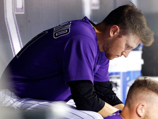 Colorado Rockies starting pitcher Kyle Freeland sits in the dugout after being pulled in the fourth inning of a baseball game against the Arizona Diamondbacks, Friday, Sept. 1, 2017, in Denver. (AP Photo/Jack Dempsey)