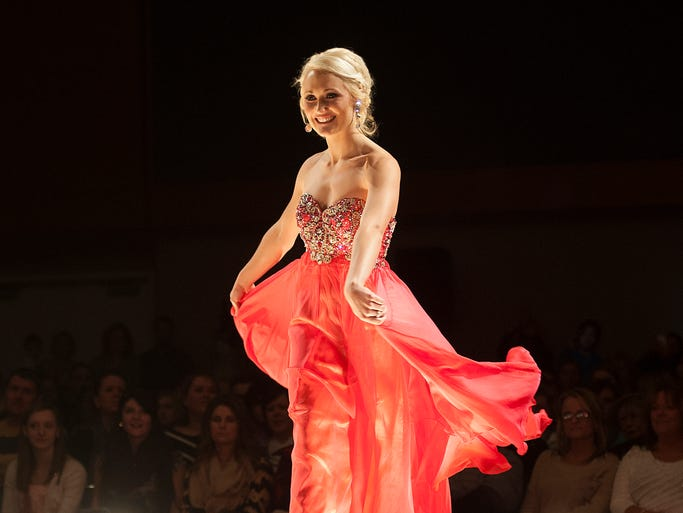 Grace Buck walks the runway Saturday, Jan. 25, 2014, at RaeLynn's 2014 Prom Fashion Show held at the Indianapolis Convention Center.