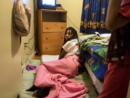 It's 6:45 am and Jalisa Allen, 10, is just waking up. She sleeps on the floor next to her cousin, Rayshawn, 5, who has the twin bed. Jalisa lives in the home during the week so she can attend school. On the weekends, she's with her mother in Bahama Terrace.