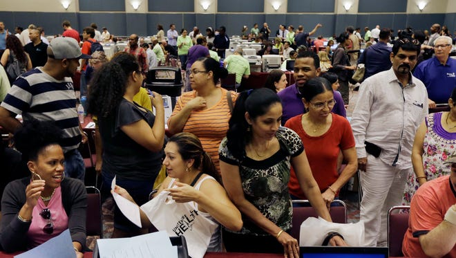 People sign up for unemployment and other benefits in September in Atlantic City, N.J.