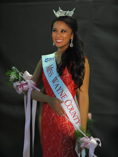 Anna Dai from Canton is all smiles after she is crowned Miss Wayne County 2014 this past Saturday at St. Valentine School in Redford.