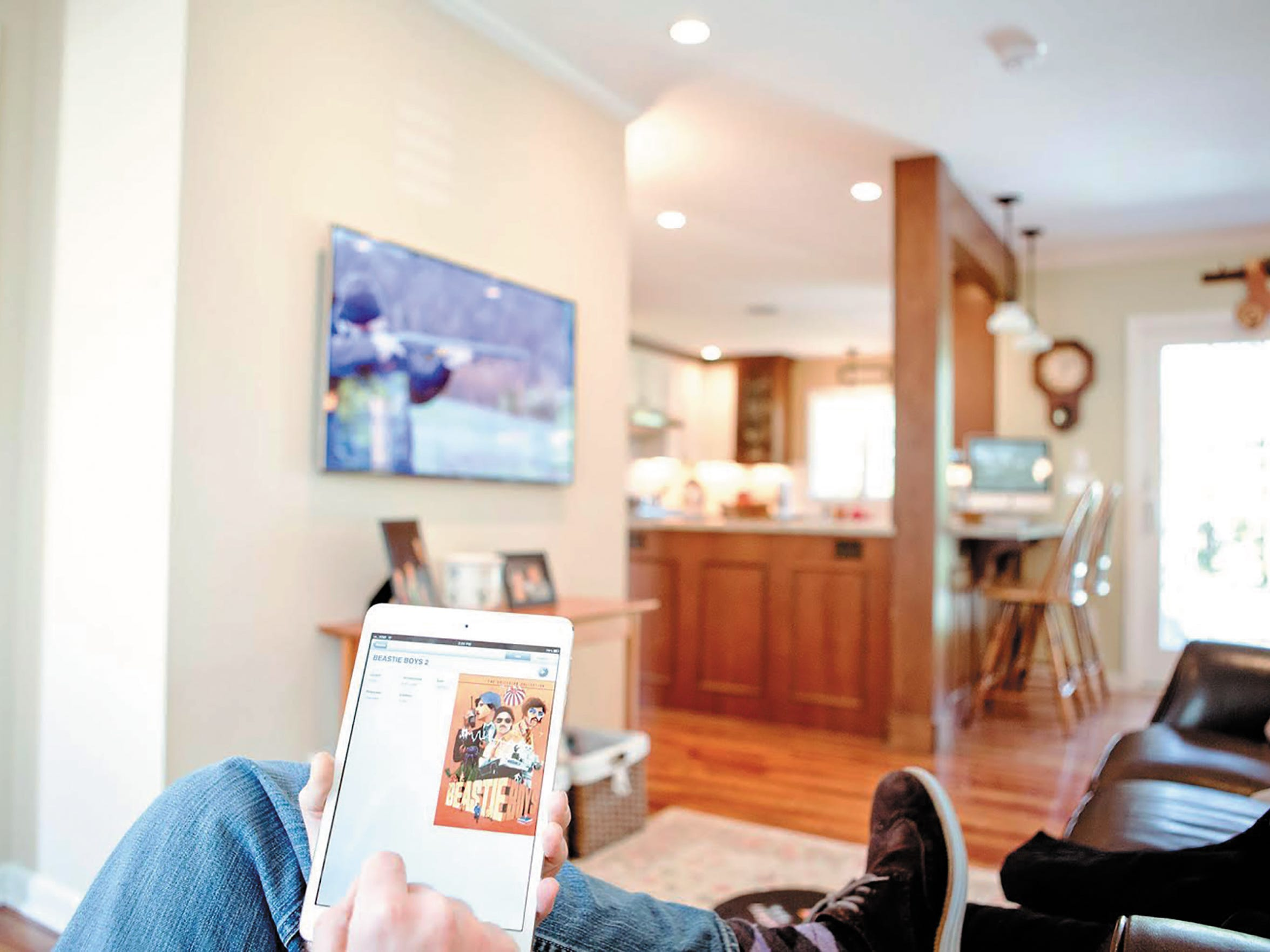 In this Brighton home, an automation system from House Digital can be controlled from a mobile device.