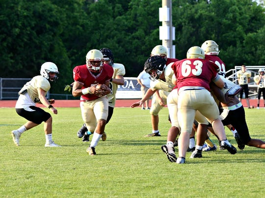 Riverdale quarterback Christian Souffrant looks for running room during Thursday's scrimmage against Bradley Central.
