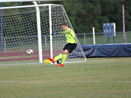 Blackman keeper Colin Dunkley boots a ball back toward
