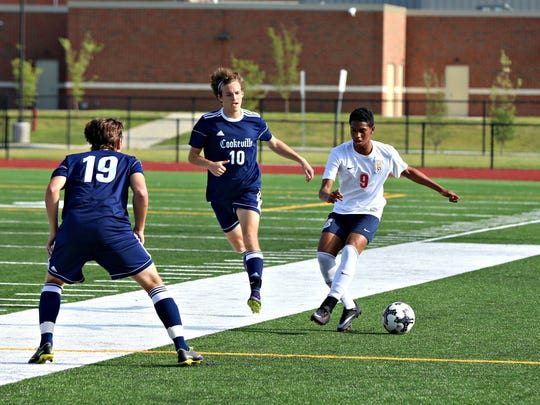 Blackman sophomore forward Nehemiah Lazo dribbles downfield as Cookeville's Darius Davis (10) and Danillo Martins (19) defend during Sunday's Class AAA sectional.