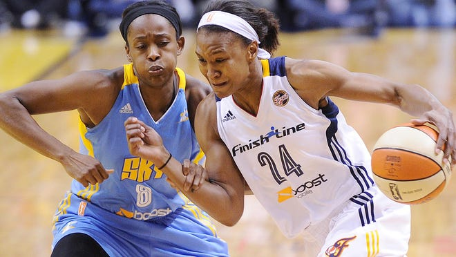 Tamika Catchings drives on Sky defender Swin Cash. The Fever hosted the Chicago Sky in WNBA playoff action at Bankers Life Fieldhouse Sunday September 22, 2013.