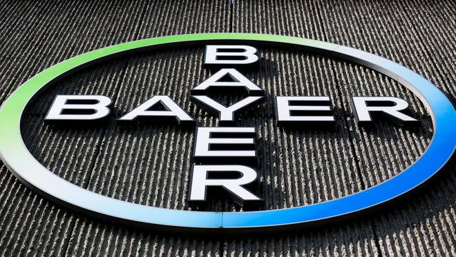 FILE - This Monday, May 23, 2016, file photo, shows the Bayer AG corporate logo displayed on a building of the German drug and chemicals company in Berlin. Bayer says it has completed its purchase of U.S. seed and weed-killer maker Monsanto Co.