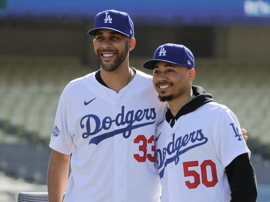 New Los Angeles Dodgers players David Price, left, and Mookie Betts pose for a picture during a news conference to announce their acquisition at Dodger Stadium in Los Angeles, Wednesday, Feb. 12, 2020. (AP Photo/Chris Carlson)