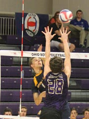 Moeller's David Wernery takes a swing against Jackson.