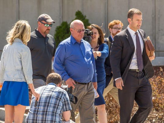 Center, Rep. Norman McAllister, R-Franklin, leaves Vermont Superior Court in St. Albans on Friday with, right, his attorney Brooks McArthur after pleading not guilty to multiple sexual assault and prohibited acts charges.
