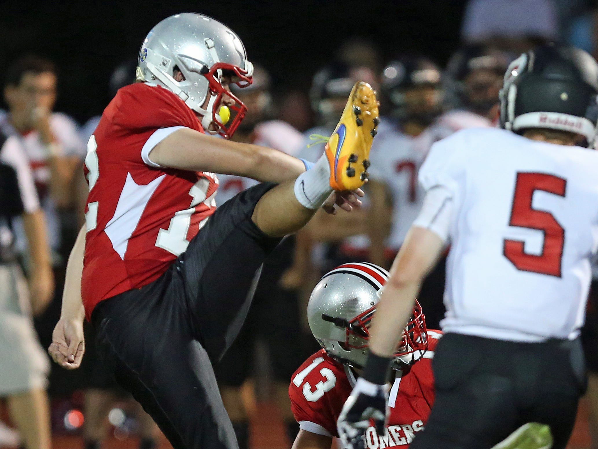 Somers' Eric Silvester (12) connects on a first half field goal against Rye, during football action at Somers High School Sept. 4, 2015