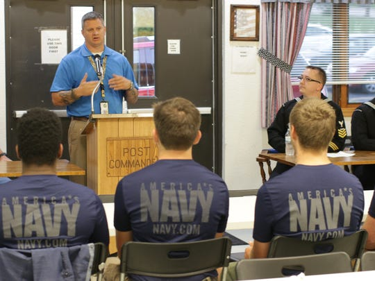 Sheboygan County assistant veterans service officer Todd Richter speaks to over a dozen U.S. Navy recruits, Wednesday, Sept. 27, at VFW Post 9156, in Sheboygan. The post honored the recruits for their choice to join the military.