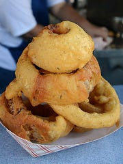 Take a break from the meat at the Nugget Rib Cook-off with sides like these beer-battered onion rings. Portions are small, as you can see.
