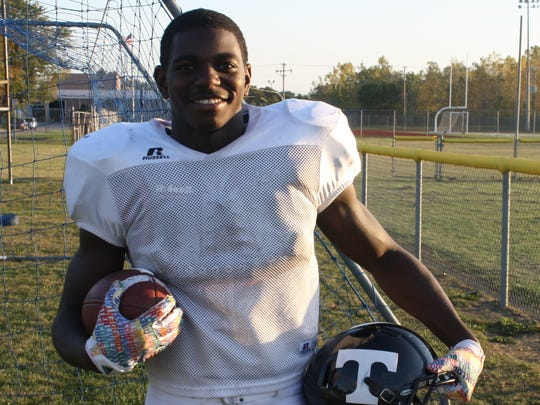 The T on Alonzo McCoy's helmet stands for Thurston, but it could also stand for thrilling, given the senior's gridiron skills.