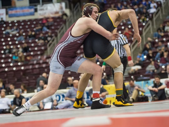 Shippensburg's Cole Forrester, left, wrestles with