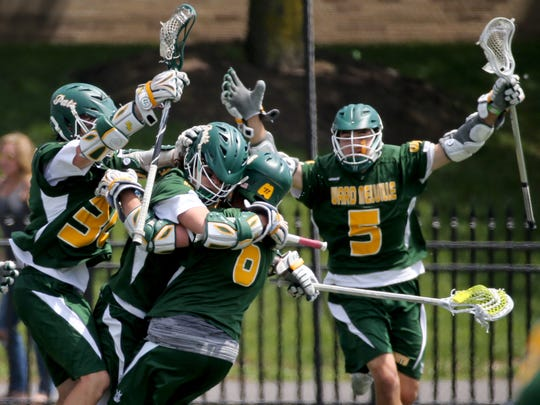 Ward Melville celebrates their win over Pittsford at State Championship.