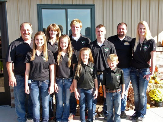 Daryl and Brenda Sternweis are pictured with their family in this October 2015 photo. The family operates 1,200 acres consisting of corn, soybeans, and alfalfa and has a rotary milking parlor on the farm.