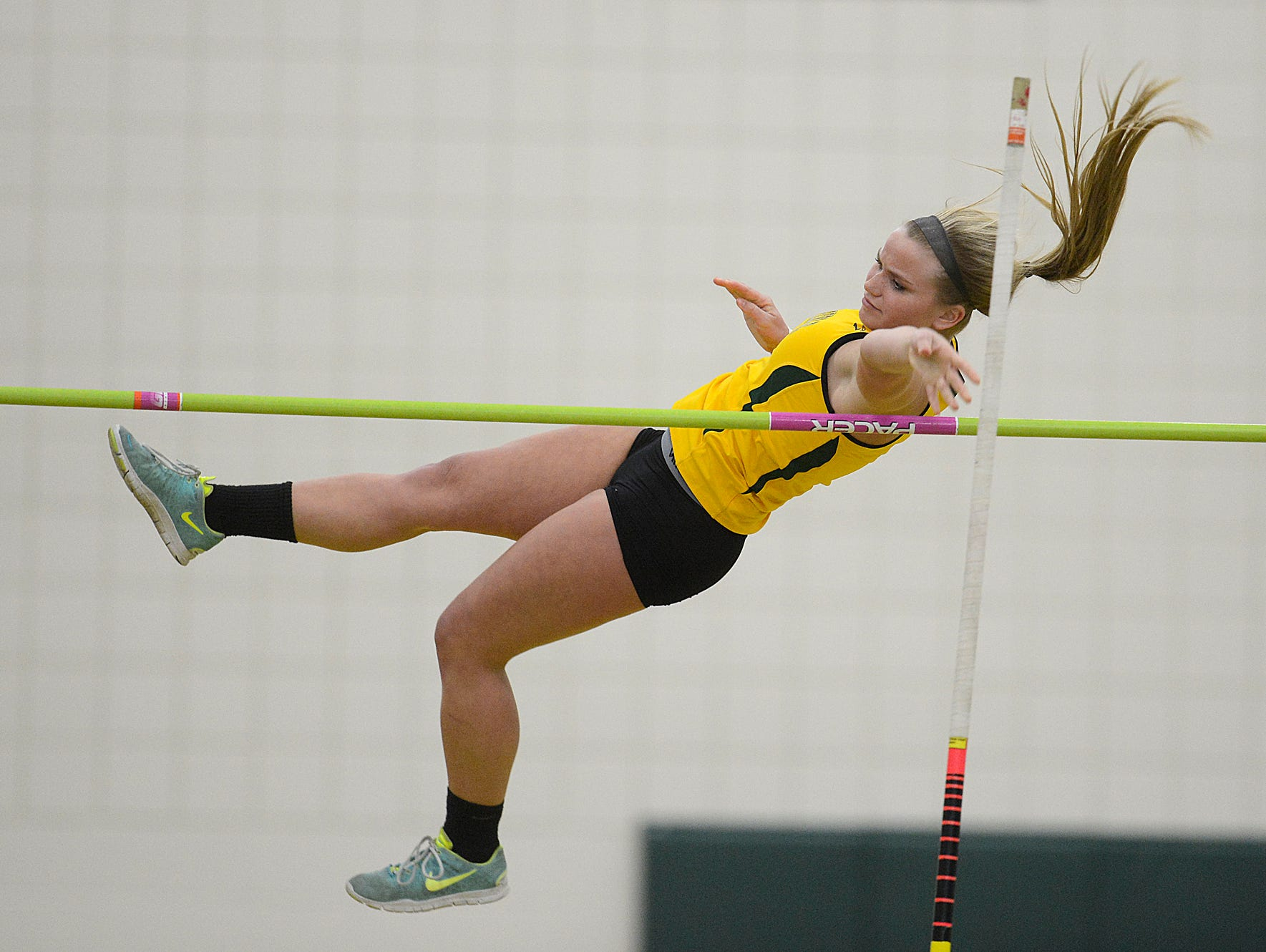 Green Bay Preble's MaKayla Hansen clears the bar while competing in the pole vault during the 16th annual Preble Indoor Invitational at Green Bay Preble High School on Wednesday, March 18, 2015.