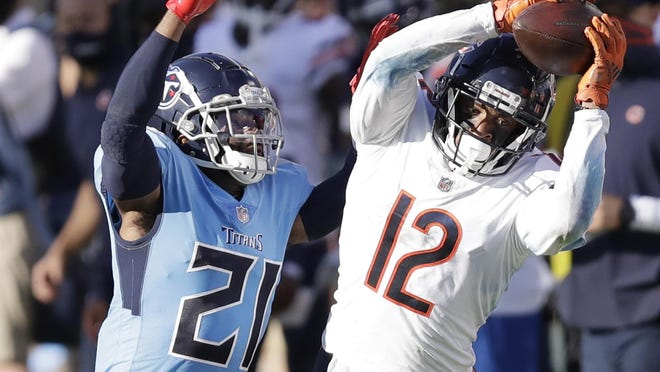 Chicago Bears wide receiver Allen Robinson (12) catches a pass as he is defended by Tennessee Titans cornerback Malcolm Butler (21) on Sunday, Nov. 8 in Nashville, Tenn.