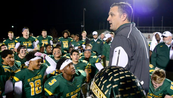Reynolds football coach Shane Laws talks to his team