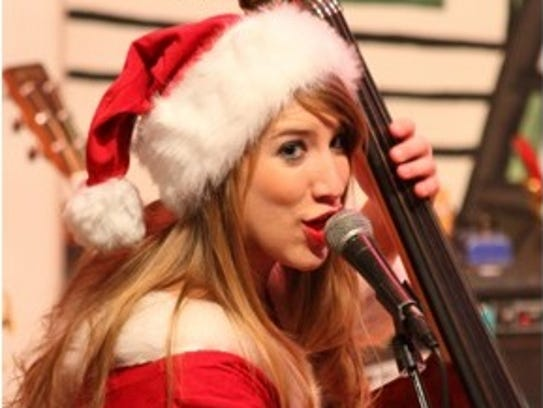 Brittney Clauson provides the Cody Clauson Trio double bass and vocals.