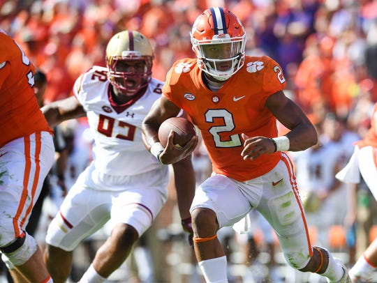 Clemson quarterback Kelly Bryant (2) scores against
