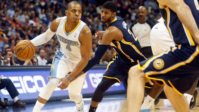 Denver Nuggets guard Randy Foye (4) drives to the basket past Indiana Pacers forward Paul George (24)  during the second half at Pepsi Center. The Nuggets won 109-96.  Jan. 25, 2014