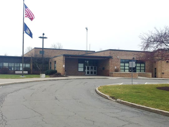 Several employees at Roth Middle School in Henrietta,