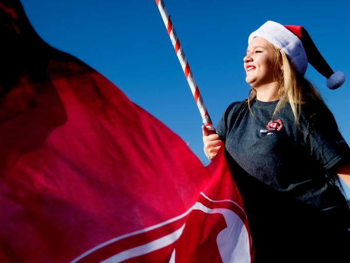 A member of the Halls color guard performs during the