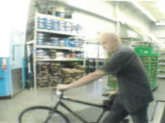 The FBI says surveillance photos show fugitive attorney Eric Conn at a Walmart in New Mexico.