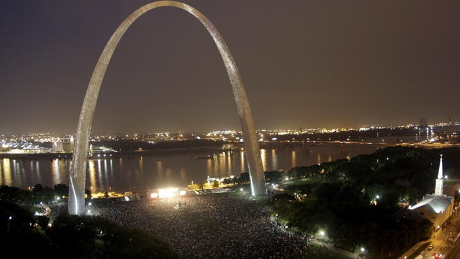FILE - In this July 11, 2009, file photo thousands watch a concert by Sheryl Crow under the Gateway Arch in St. Louis. Video shows a mysterious light appearing high over the arch on August 2, 2016. (AP Photo/Jeff Roberson, File)
