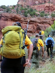 Crews with the Zion Canyon Search and Rescue team were hiking through drainage areas in the park in September looking for the remaining members of a party of seven people who had turned up dead or missing after a flash flood.