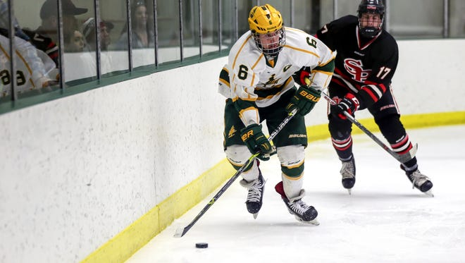 D.C. Everest's Ryan Begley moves up the ice followed by SPASH's Cole Beilke during a WIAA boys hockey sectional final Saturday. The Evergreens earned their first state tournament appearance with the win in two overtimes.