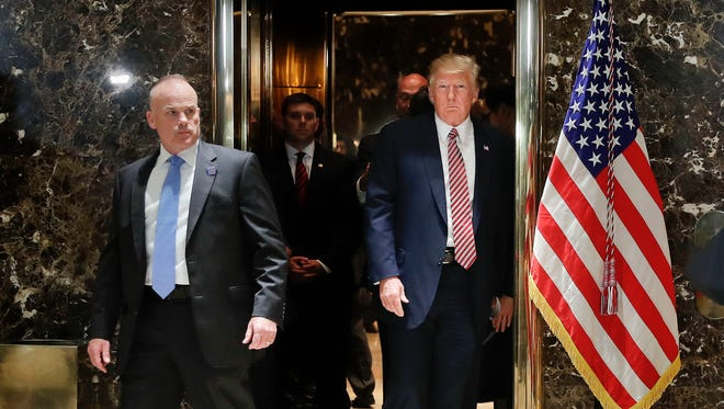 In this Aug. 15, 2017, photo, President Donald Trump steps out of the elevator to speaks to the media in the lobby of Trump Tower in New York.